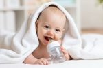 Baby drinking water from the bottle